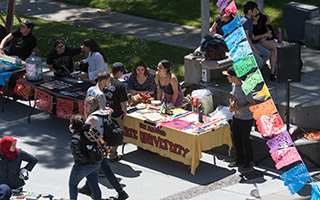 Booths advertising different clubs in Malcolm X Plaza