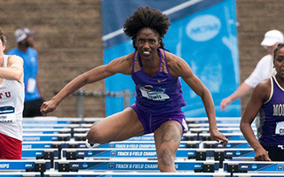 Monisha Lewis jumping over barriers
