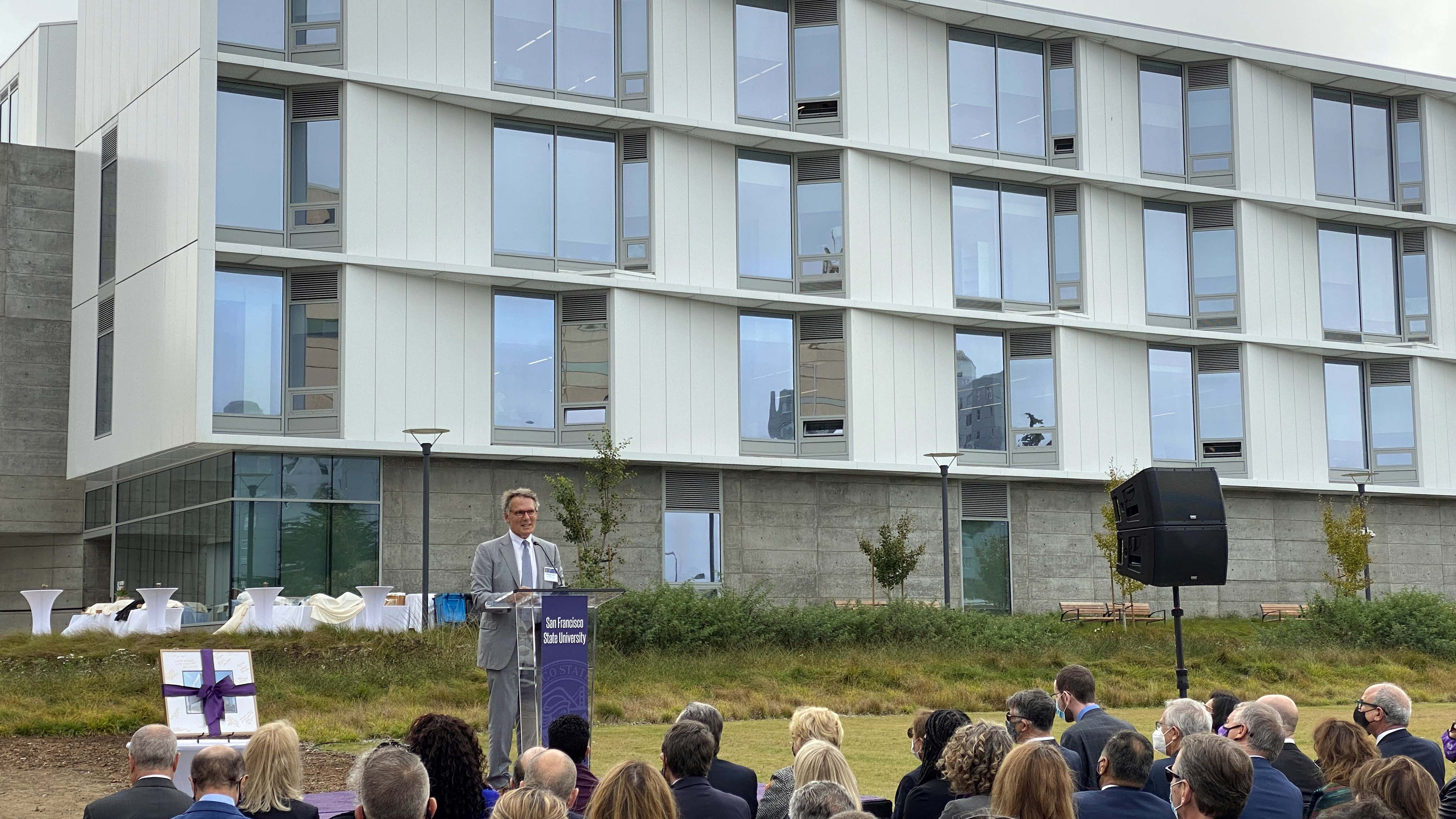 Mark Cavagnero of Mark Cavagnero Associates, the architectural firm that designed Marcus Hall, speaks at the building's dedication ceremony
