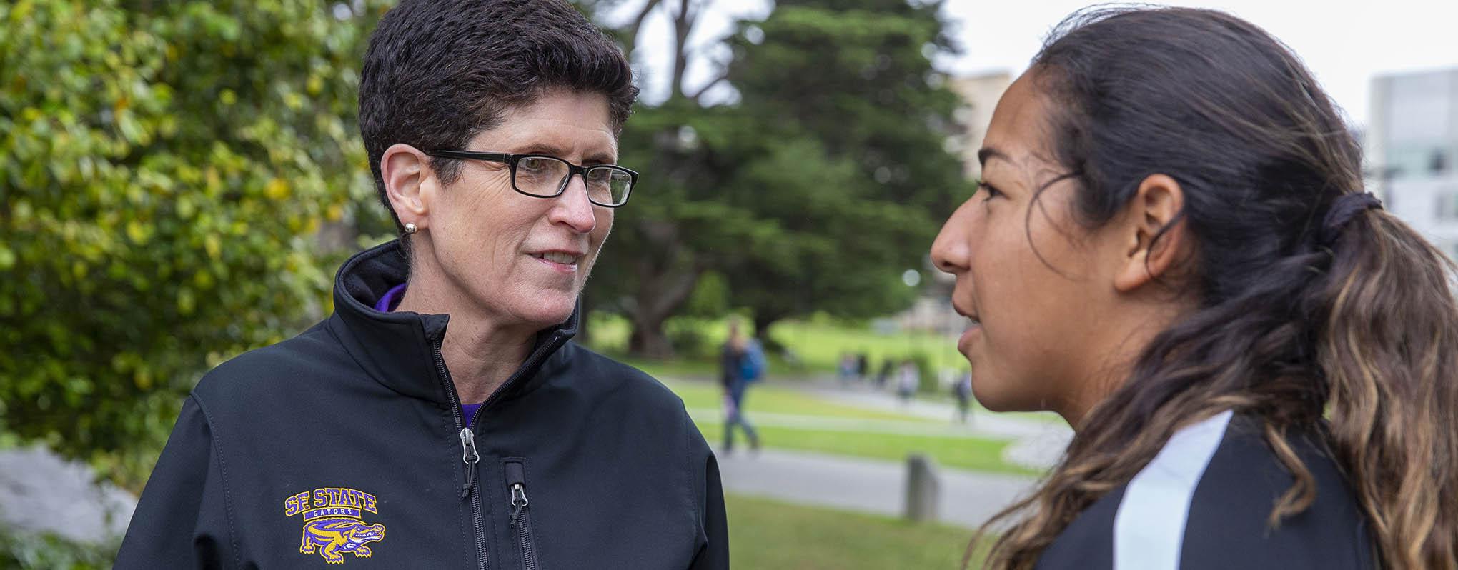 President Mahoney speaks with student