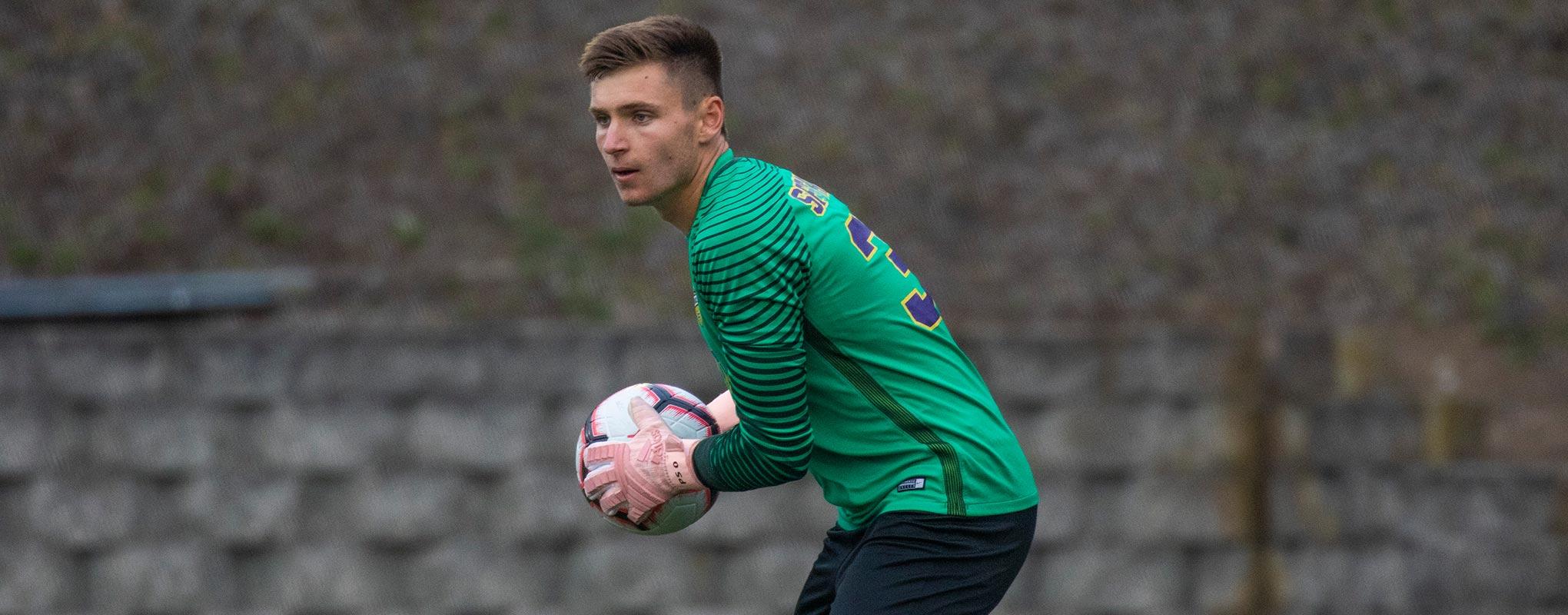 Soccer player Peter Swinkels holding soccer ball