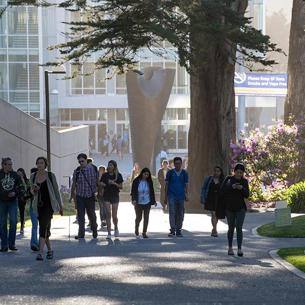 Students walking on walkway on campus