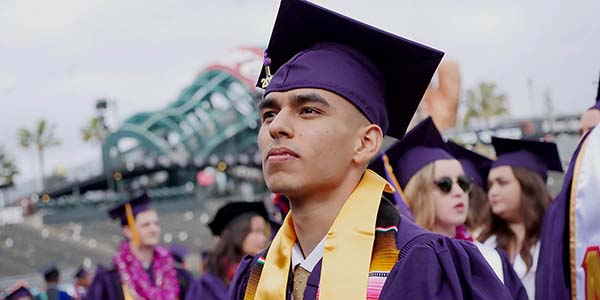 SF State graduate looking upwards at graduation