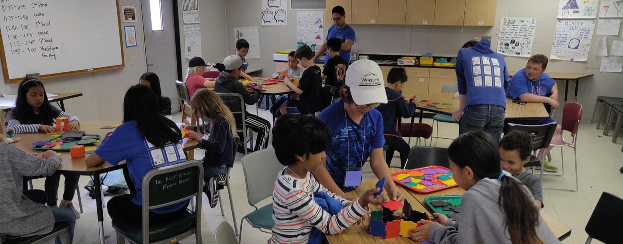 SFSU Math Circle members helping children learn