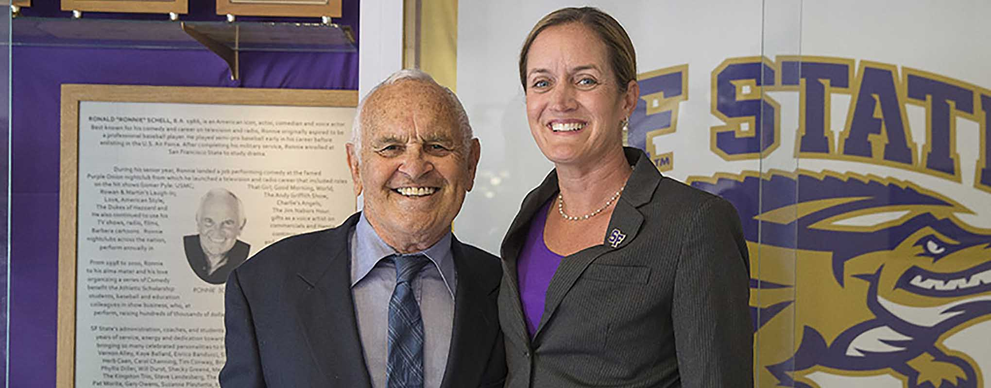 Actor and comedian Ronnie Schell and San Francisco State Athletics Director Stephanie Shrieve-Hawkins