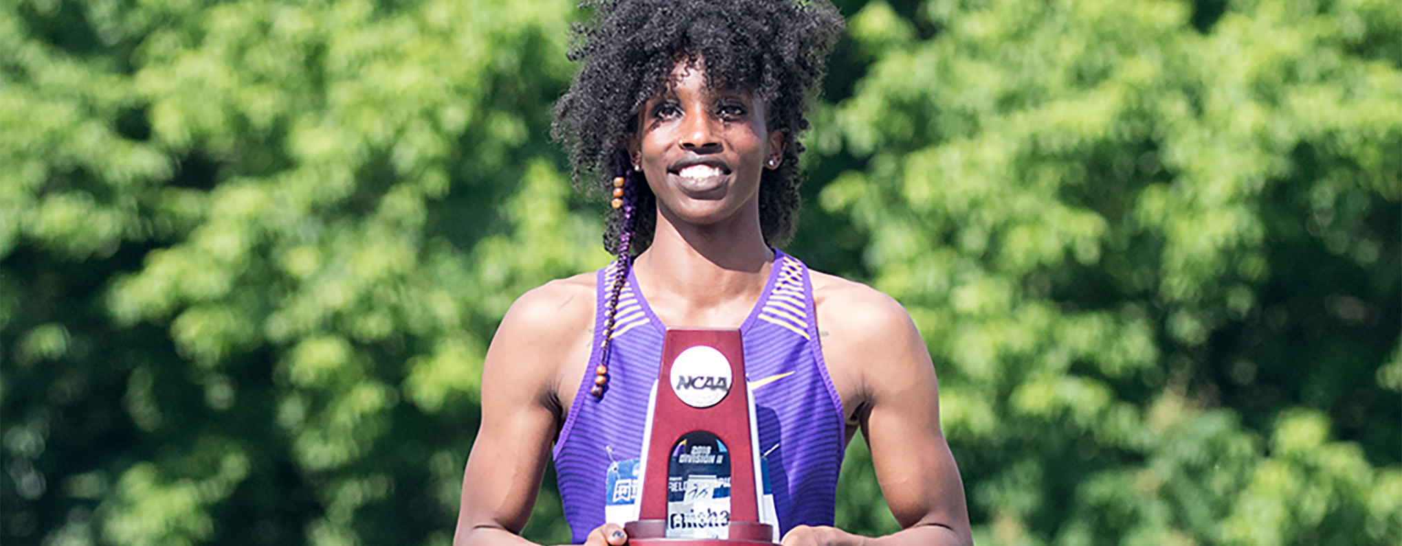 Monisha Lewis with award