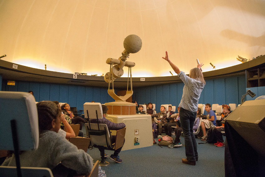 Students and instructor inside the planetarium