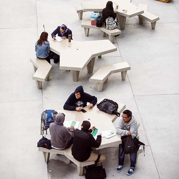students sitting at outside table